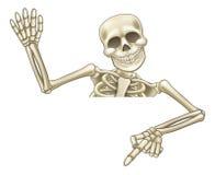 Zeige- und wellenartig bewegendes Karikatur-Skelett Lizenzfreie Stockbilder