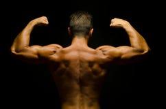 Zeigen der Muskeln Stockfotos