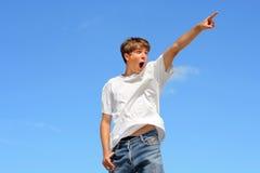 Zeigen des Jugendlichen Stockbilder