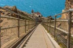 Zeigen Sie Reyes-Leuchtturm auf Ende von 300 Schritten Stockfotos