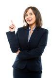 Zeigende und blinzelnde Geschäftsfrau Lizenzfreie Stockfotos
