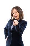 Zeigende und blinzelnde Geschäftsfrau Lizenzfreies Stockfoto