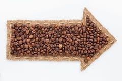 Zeiger mit Kaffeebohnen Lizenzfreie Stockfotografie