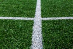Zeile auf dem grünen Gras Stockfoto