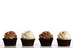 Zeile der kleiner Kuchen lizenzfreie stockbilder
