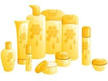 Zeile der Schönheitsprodukte, mit einer Bienenwabeauslegung Lizenzfreie Stockfotografie