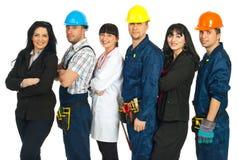 Zeile der verschiedenen Arbeitskräfte lizenzfreie stockbilder