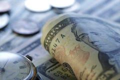 Zeit - ein Geld Blauer Ton Abschluss-oben - Archivbild Stockbild
