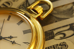 Zeit - ein Geld Goldtone Abschluss-oben - Archivbild Stockfotografie
