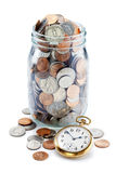 Zeit-Geld-Münzen-Ruhestands-Glas stockbilder