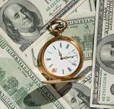 Zeit- und Geldkonzeptbild. Stockfotos