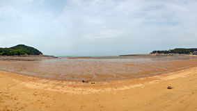 Zeit von Gezeiten am Strand Lizenzfreies Stockfoto