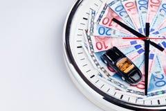 Zeitgeld und ein Auto Stockfotografie
