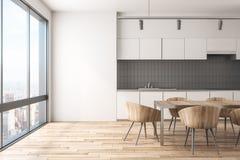 Zeitgenössischer Kücheninnenraum mit Tageslicht lizenzfreie abbildung