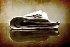 Zeitung rollte oben lizenzfreie stockbilder