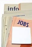 Zeitungen der gestapelten Jobs Lizenzfreie Stockbilder