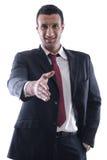 Zekere bedrijfsmens die u een handschok geeft Stock Foto's