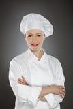 Zekere jonge vrouwelijke chef-kok royalty-vrije stock foto's