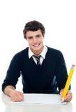 Zekere student die nota's neerschrijft Royalty-vrije Stock Afbeelding