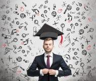 Zekere zakenman en onderwijspictogrammen Stock Foto's