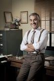 Zekere zakenman in zijn bureau Royalty-vrije Stock Foto