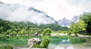 Zelenci pond and Julian Alps in Kranjska Gora, Slovenia Stock Image