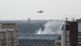 Zelenograd, Russia - May 31.2016. Extinguishing the fire by helicopter stock video