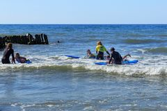 ZELENOGRADSK, KALININGRAD REGION, RUSSIA - JULY 29, 2017: Unknown children resting and learning of surfing. Unknown children resting and learning of surfing Royalty Free Stock Photography