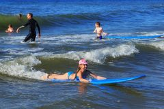 ZELENOGRADSK, KALININGRAD REGION, RUSSIA - JULY 29, 2017: Unknown children resting and learning of surfing. Unknown children resting and learning of surfing Royalty Free Stock Photos