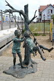 ZELENOGRADSK, RUSSIA. Sculptural composition `Children shake on a swing` Royalty Free Stock Photo