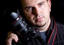 Zelf portret van de fotograaf met camera DSLR Royalty-vrije Stock Afbeeldingen
