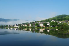 Zell Mosel & vineyards. Reflections on Zell on Mosel river, Germany Royalty Free Stock Image