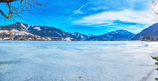 Zeller see lake in winter, Zell am See, Austria. Winter panorama of Zeller see lake, covered with ice and snow and surrounded by Alpine ranges, Zell am See stock photography