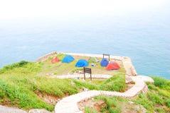 Zelte und Meer Stockbild