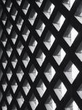 Zementplattenwandmusterschatten Beleuchtungs-Architekturdetails stockbild