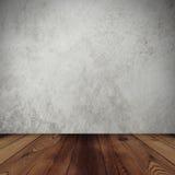 Zementwandhintergrund und -Holzfußboden Lizenzfreie Stockfotos