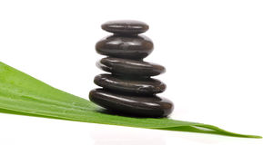 Zen. Stacked zen stones on fresh leaf Royalty Free Stock Photography