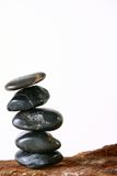 Zen. Pebbles on a rock with white background Stock Photos