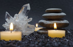 Zen. With crystal, stone and candle light in black sand Stock Image