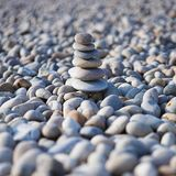Zen. Stacked smooth stones - shallow depth of field stock image