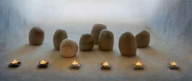 Zen. Still life with rounded stones and candles Stock Images