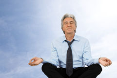 Zen. Gray-haired businessman relaxing and meditating Royalty Free Stock Photos