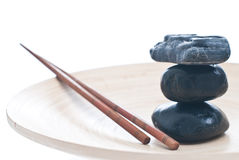 Zen attitude. Spa relaxing with plate, zen sticks and stones Stock Photo