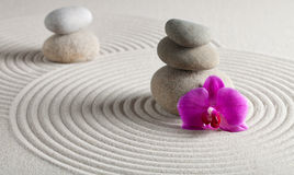 Zen Background. Two Stack of stones and a orchid on raked sand - a niche zen-like backgorund Stock Photo