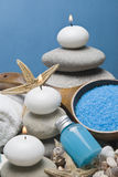Zen balance and blue spa. Spa background with some blue hygiene items and zen balanced stones Royalty Free Stock Images