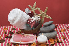 Zen balance and red spa. Some hygiene items and stones in zen balance on a red bamboo mat Stock Photo