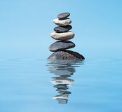 Zen balanced stones stack in lake  balance peace silence concept. Zen meditation background -  balanced stones stack in water with reflection Royalty Free Stock Photography