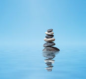 Zen balanced stones stack. Zen meditation background -  balanced stones stack in water with reflection Stock Photography