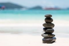 Zen Balancing Pebbles on Beach. Symbols Of Peace Stock Photo