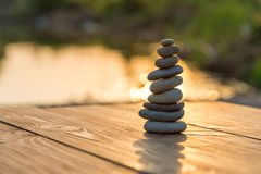 Zen Balancing Pebbles Next to a Misty Lake Stock Photography